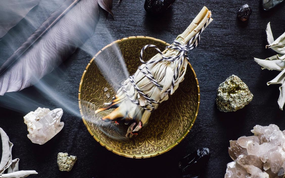 set the new moon intentions Smudging-with-white-sage